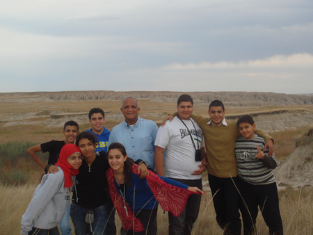 Egyptian students posing in front of the South Dakota badlands