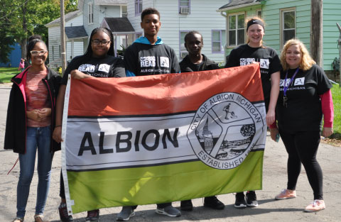 Student leaders and Albion College volunteers walked in Albion's NEA Big Read Kick-Off Parade. Photo by Madeline Drury.