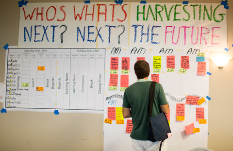 "Sign reads ""Who's next? What's next? Harvesting the future."""