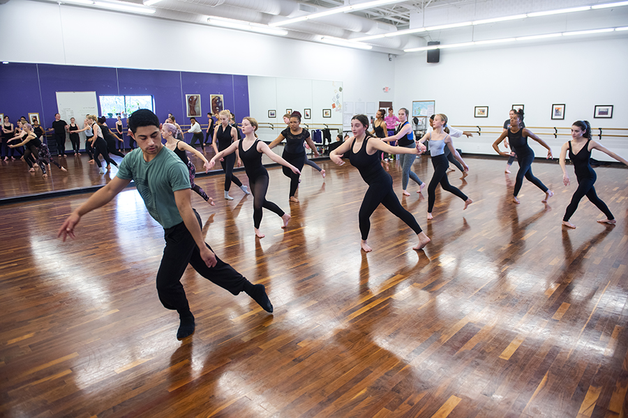A dance class with a visiting artist teaching moves to the class