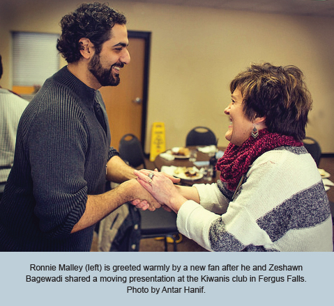 Ronnie Malley (left) is greeted warmly by a new fan after he and Zeshawn Bagewadi shared a moving presentation at the Kiwanis club in Fergus Falls. Photo by Antar Hanif.