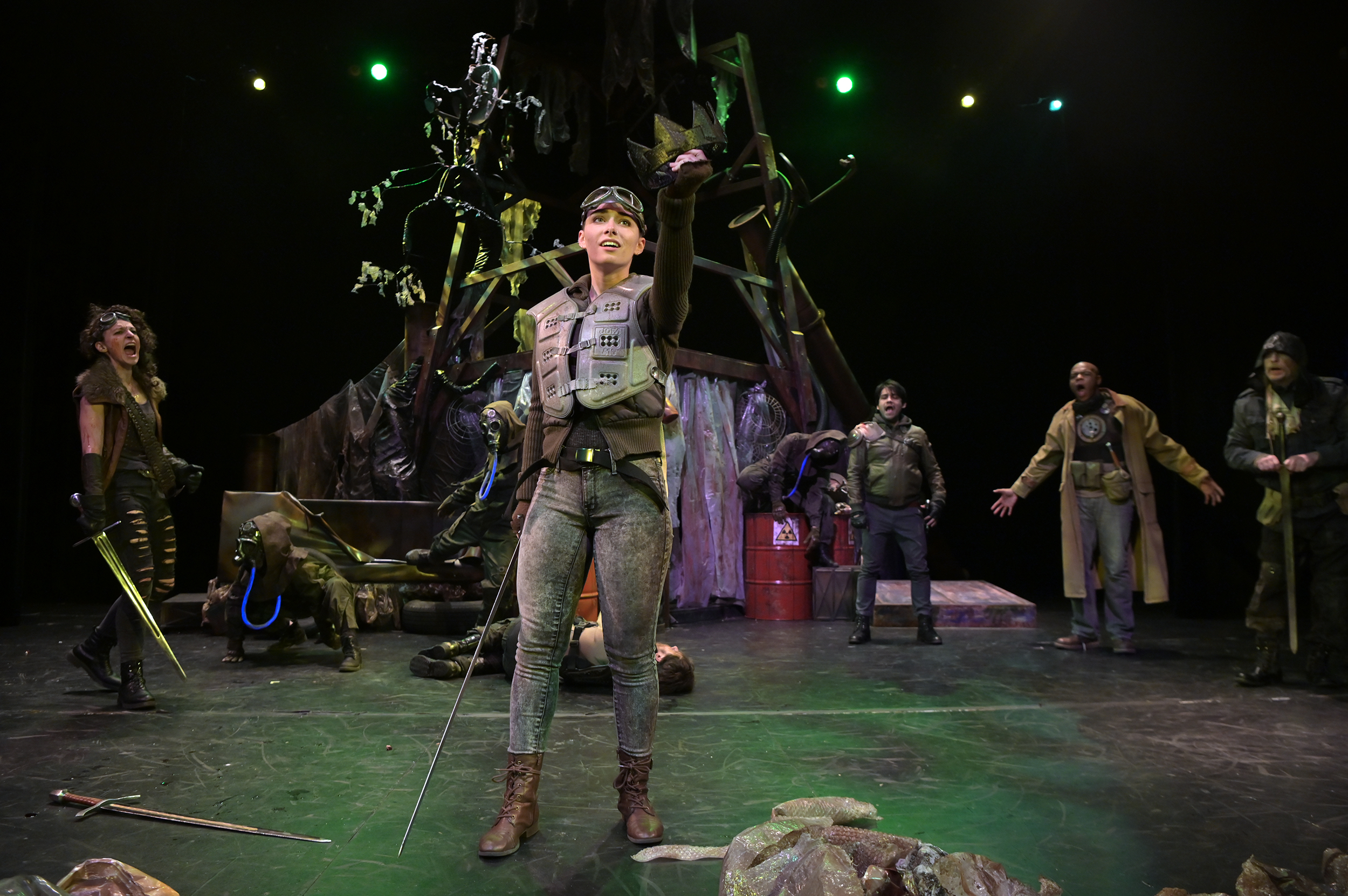 Performance of Macbeth, with actor raising fist to the sky.