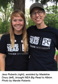 Jess Roberts (right), assisted by Madeline Drury (left), brought NEA Big Read to Albion. Photo by Mardie Roberts.