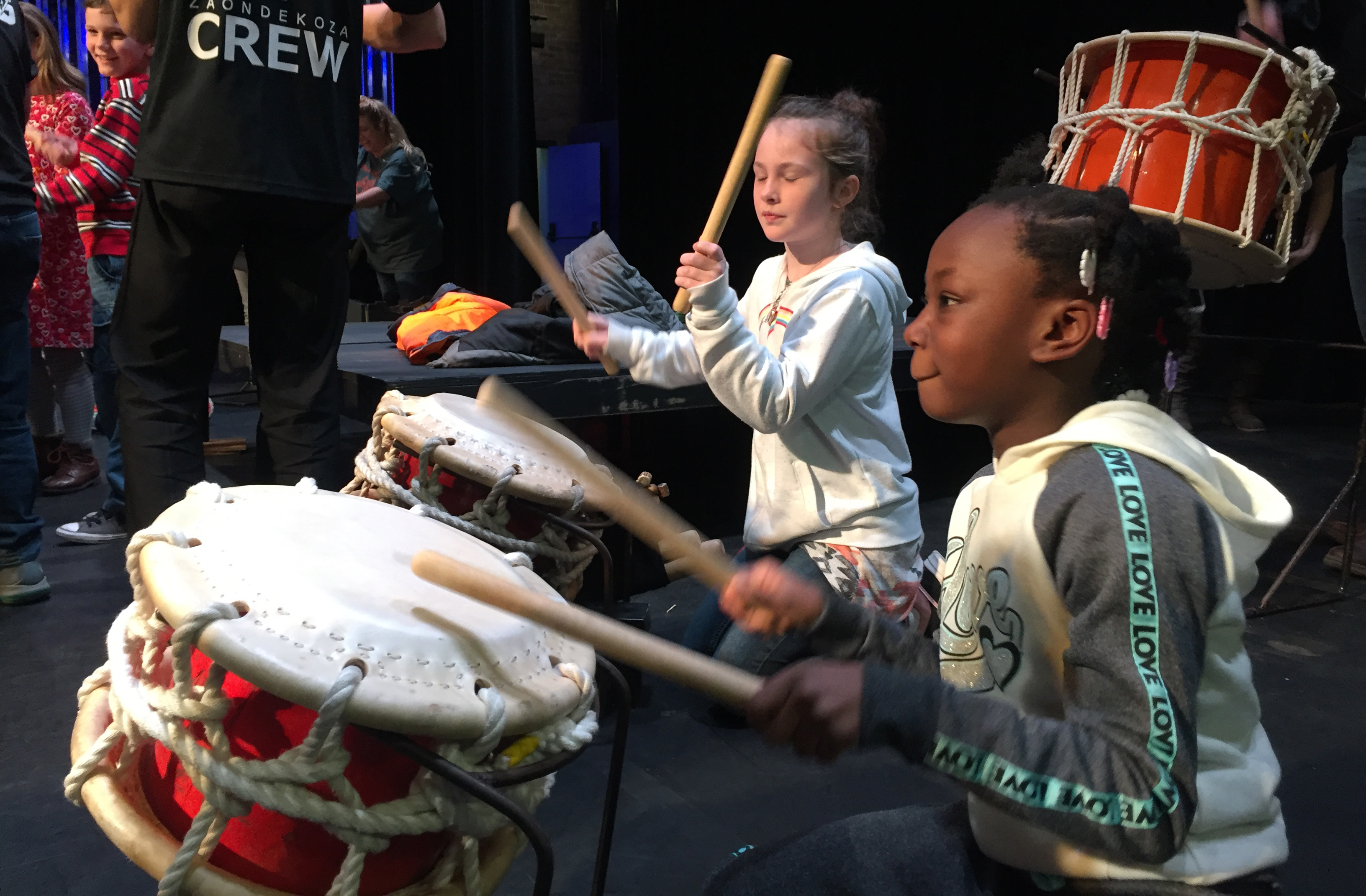 Students playing Taiko drums at Ondekoza's workshop at Peoples Bank Theatre. Photo by Luke Rivard.