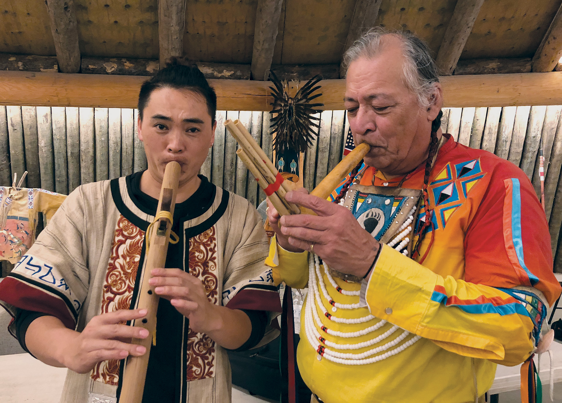 Two men playing wind instruments