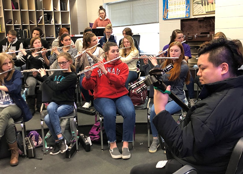 Yuji plays his Shamisen with Lanesville High School Band.