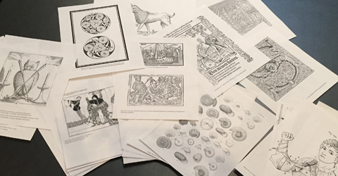 Coloring pages spread out on the table