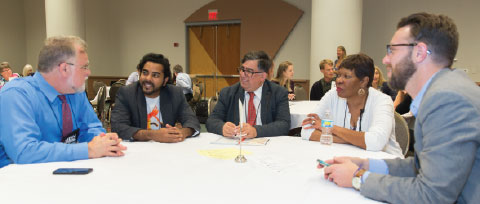 new colleagues gather at a round table at the Conference