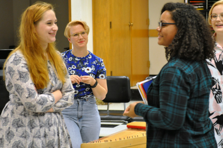 A student tries a few words of Finnish and shares about her own Finnish and Swedish heritage after a workshop with Kardemimmit at Hibbing High School