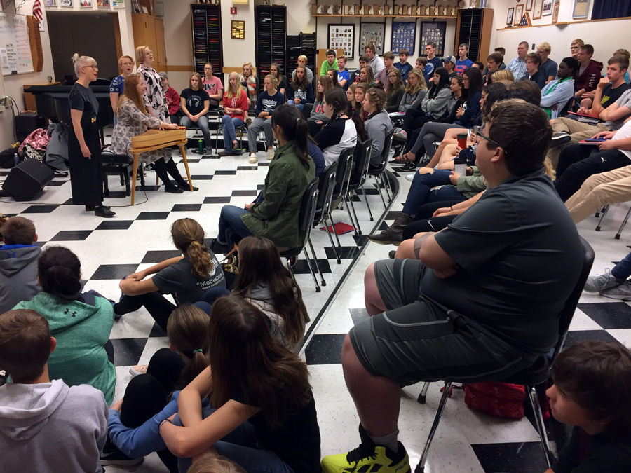 A packed choir room listens to traditional songs from Finland during Kardemimmit's visit to Hibbing High School
