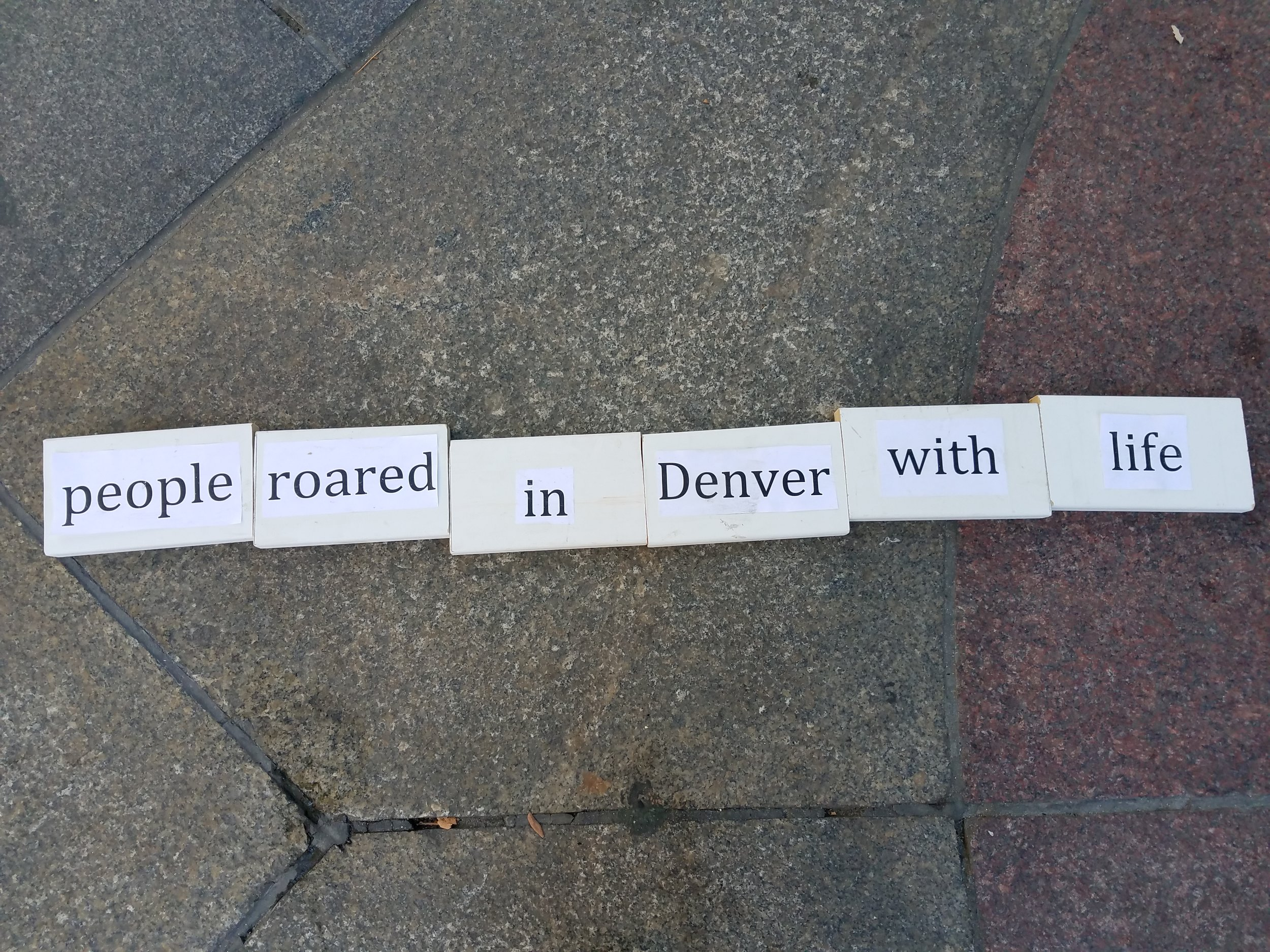 "Sidewalk poem line ""people roared in Denver with life"""