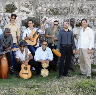 Photo of the members of Havana Cuba All Stars with their instruments.