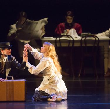 Dancers representing Helen Keller and Anne Sullivan meeting and interacting onstage during performance of A Light in the Dark.
