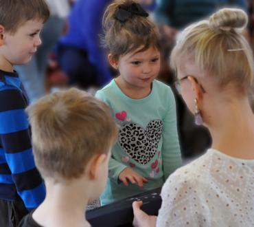 Pre-schoolers got to try a kantele during a workshop at United Presbyterian Home Health Center.