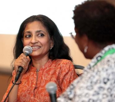 A woman speaks into a microphone