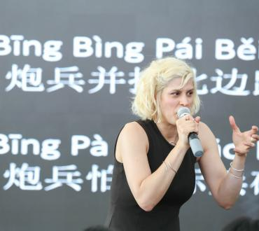 Dessa leads the audience in a rap created from a Chinese tongue twister. Photo by Wilson Tong, courtesy of Guangzhou Opera House.