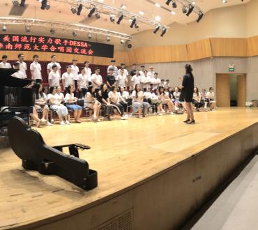 Dessa and Aby Wolf listen to a performance by the South China Normal University Choir. Photo by Yu Pei.