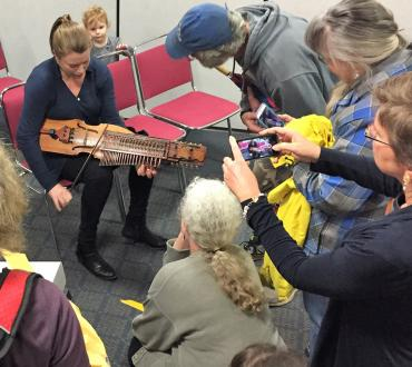 Workshop attendees at Northern Michigan University in Marquette, MI, learn about the nyckelharpa. Photo by Stephen Manuszak.
