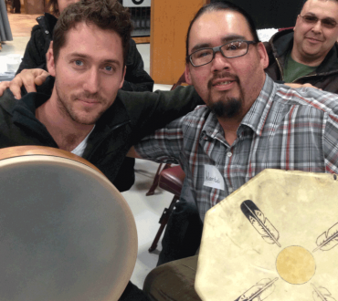Israeli and Native American musicians exchange musical traditions from their respective cultures, including similarities between percussion instruments.