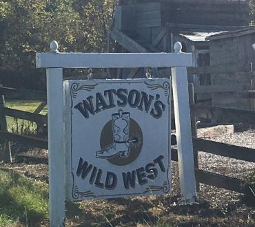 Wooden sign for Watson's Wild West Museum