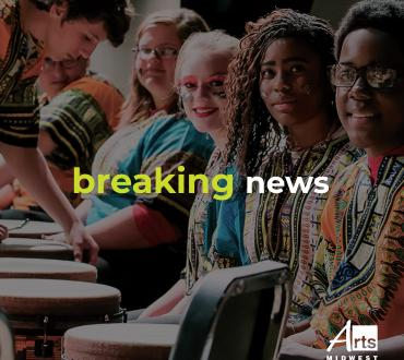 TEXT: Breaking News over an image of Roseville High School Arts Midwest World Fest Workshop. Photo by Joshua Feist.