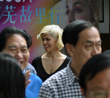 Dessa mingles with a crowd at the home of Ai Wu, a Chinese writer who lived from 1904 to 1992.