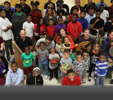 Musicians from Sofi and the Baladis pose with a large group of school children from Flint Michigan.
