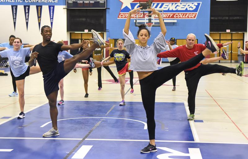 Dance Theater of Harlem dancers lead a masterclass with Cuyahoga Community College's women's track team.