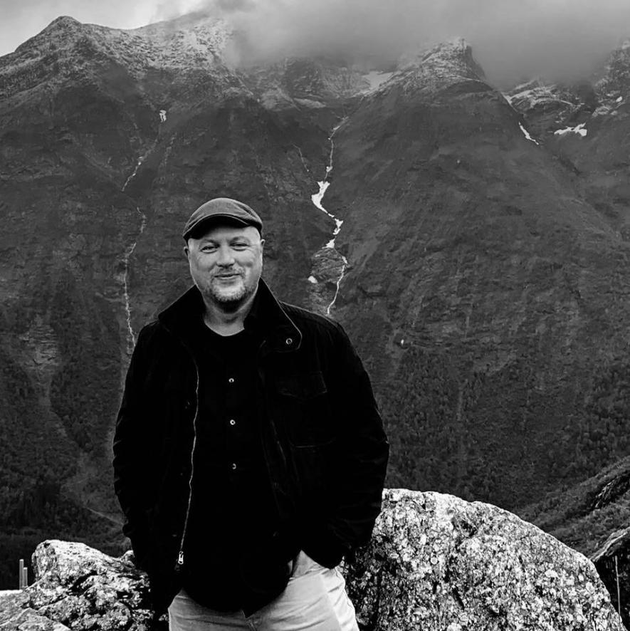 Adam Perry standing on a mountain in Norway.