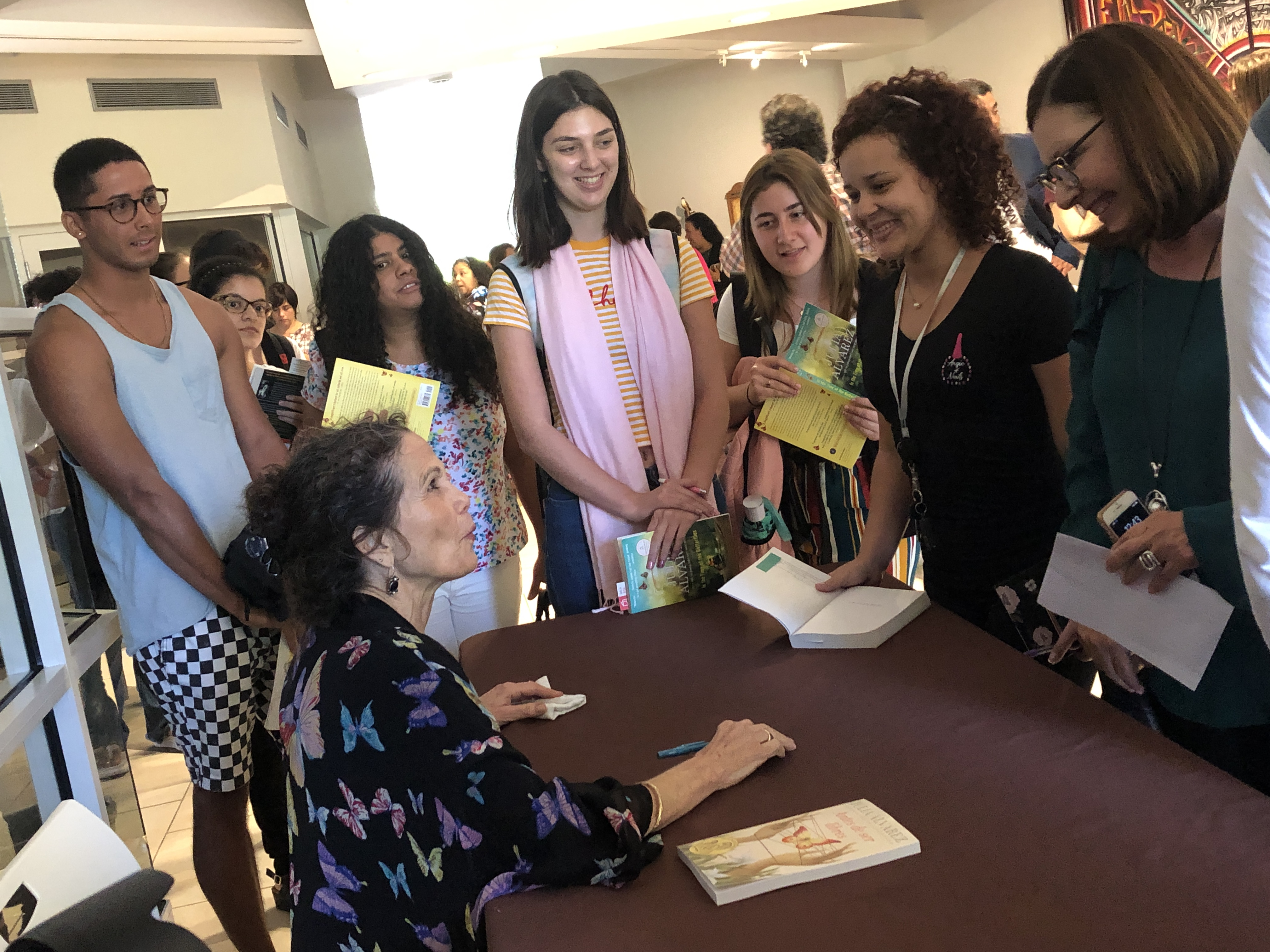 Students getting books signed by Julia Alvarez.